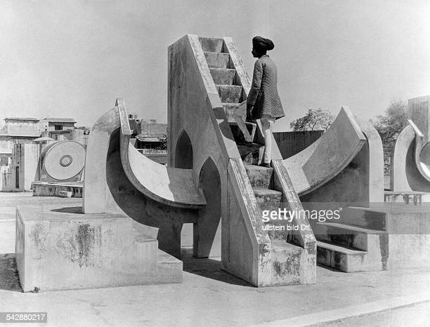 observatory Jantar Mantar in Jaipur a man on the astronomic installation undated about 1927 photographer Martin Hürlimann