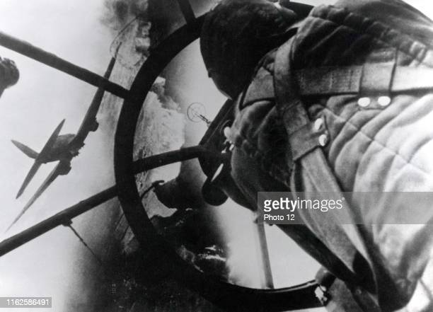 Observer in the plexiglass nose of a German bomber Heinkel He111 during the Battle of Britain August 1940