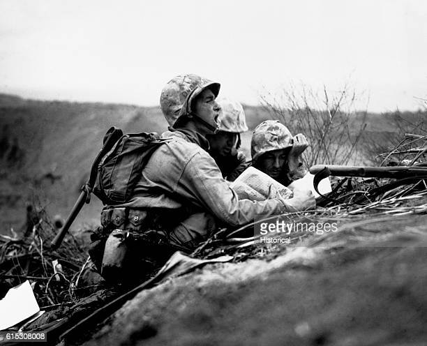 Observer who spotted a machine gun nest finds its location on a map so they can send the information to artillery or mortars to hit the position Iwo...