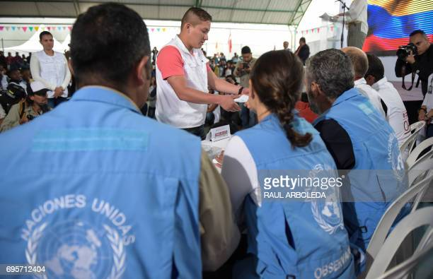 UN observers attend a symbolic act with members of the Revolutionary Armed Forces of Colombia as part of the peace process in Buenos Aires Cauca...