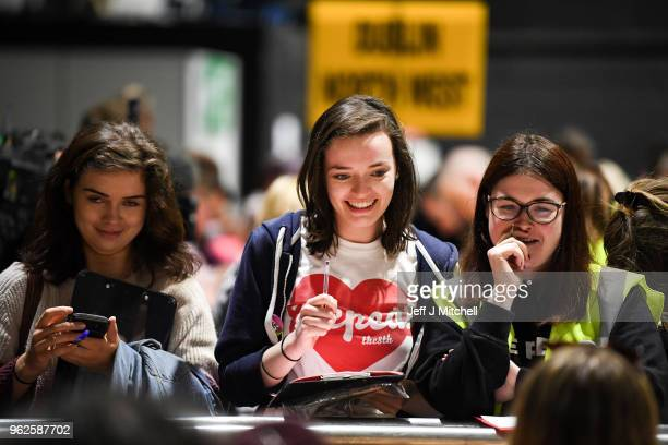 Observers look on as the count in the Irish referendum on the 8th amendment concerning the country's abortion laws takes place at the RDS centre on...