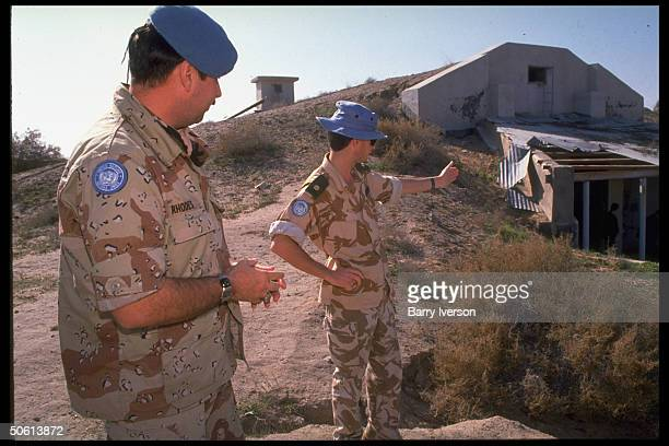 UNIKOM observers on duty at UN base in gulf war demilitarized zone between Iraq Kuwait by bunker prob once housing Silkworm missiles stolen by Iraq