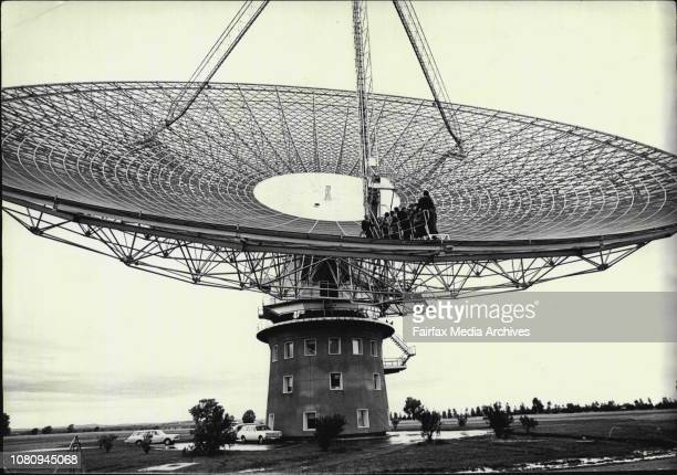 Observers ride 100ft into the air inside the giant 210ft diameter radio telescope dish form ground level to horizontal July 18 1969