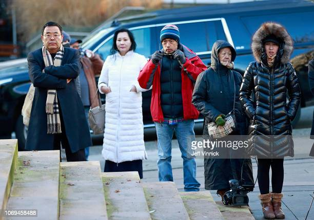 Observers stand outside the BC Supreme Courthouse as they wait for news at the bail hearing for Huawei Technologies Chief Financial Officer Meng...