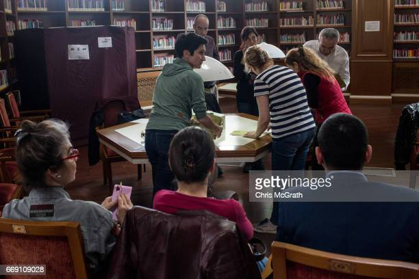 Observers watch as referendum staff sort through votes ahead of counting after polls closed on April 16 2017 in Istanbul Turkey Constitutional...