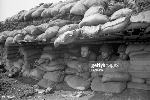 Observing Khe Sanh South Vietnam Marines peer through an opening in a bunker at this beleaguered outpost in northern South Vietnam March 2nd