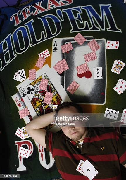 ID obsession 04/10/06 OSHAWA ONTARIO Durham College student Aaron Armstrong with some of his poker materials