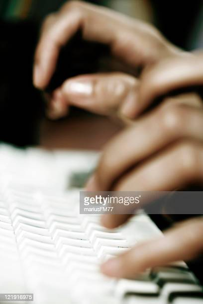 obsession - hands typing on keyboard.Shallow depth-of-field.