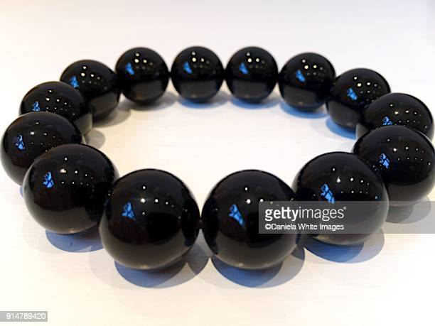 obsidian beads bracelet - bead stock pictures, royalty-free photos & images
