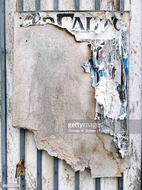 obsolete advertising - peeling off stock photos and pictures