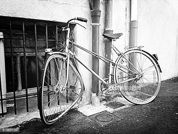 Obsolete Bicycle Lying On Wall