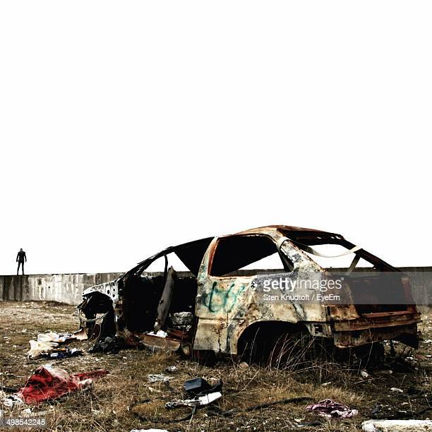 obsolete car in field against clear sky - obsolete stock pictures, royalty-free photos & images