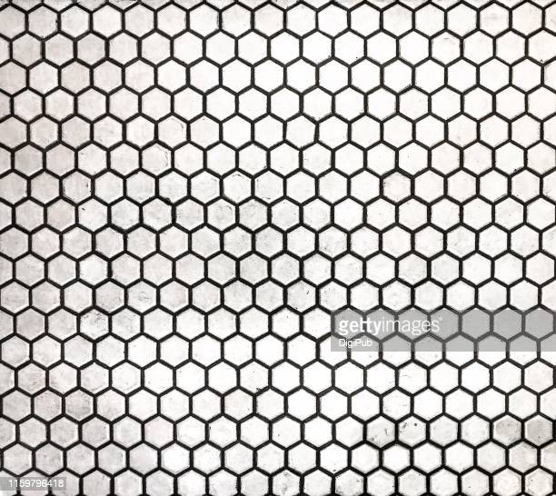 obsolete flooring covered with hexagon shaped ceramic tiles - tiled floor stock pictures, royalty-free photos & images