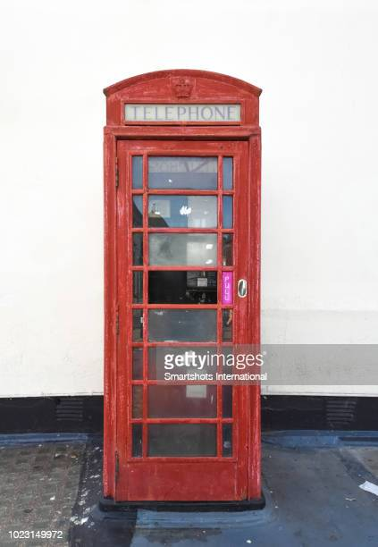 Obsolete, old-fashioned UK red telephone box in London, England, UK