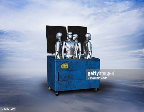 Obsolete robots in garbage dumpster