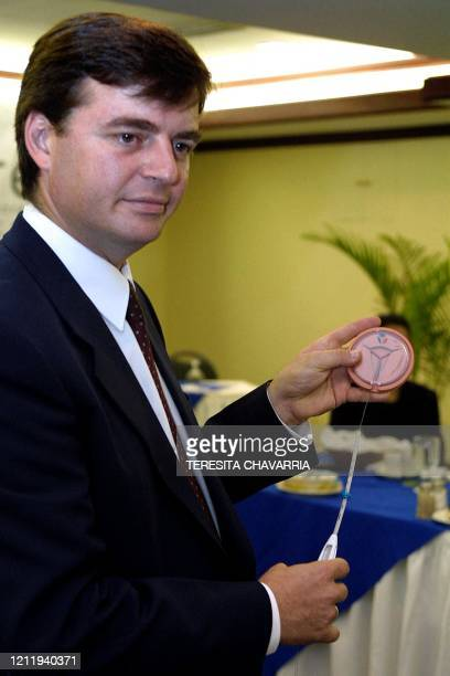 Obstetrician Adam Paer presents a model of a new contraceptive designed for uteral implantation 25 May 2001 San Jose Costa Rica German pharmaceutical...