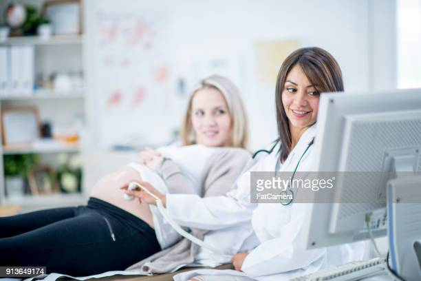 obstetrician - obstetrician stock photos and pictures
