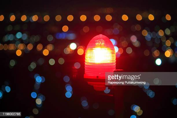 obstruction light on the roof building at night - emergency siren stock pictures, royalty-free photos & images