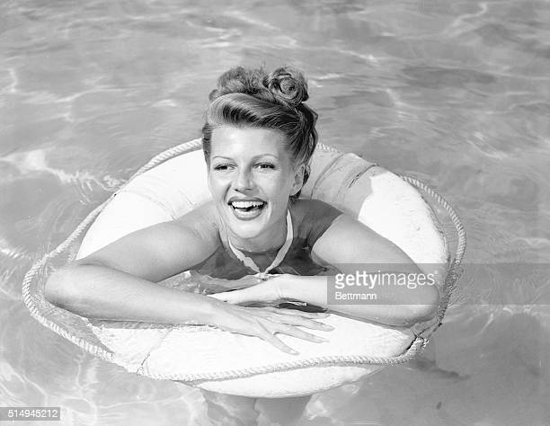 Obviously in top form Columbia actress Rita Hayworth wife of actor Orson Welles takes time out from filming of Gilda to pose for the first leg art...