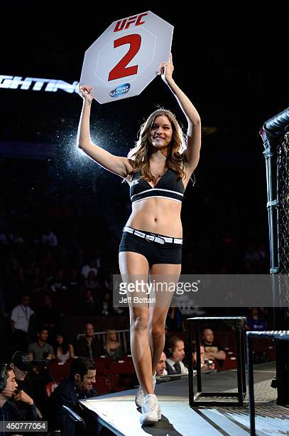 Ocatgon Girl Vanessa Hanson signals the start of round two between Roland Delorme and Michinori Tanaka during the UFC 174 event at Rogers Arena on...