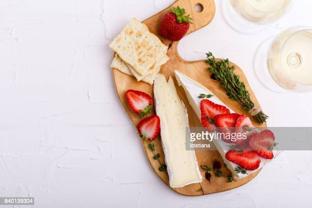 Occasions. Brie with fresh strawberries and thyme
