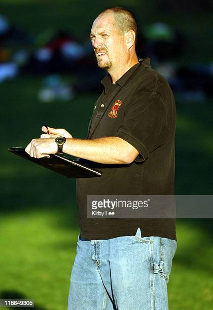 Occidental College cross country coach Troy Engle records splits during the SCIAC Cross Country Dual Meets men's race at La Mirada Park in La Mirada...