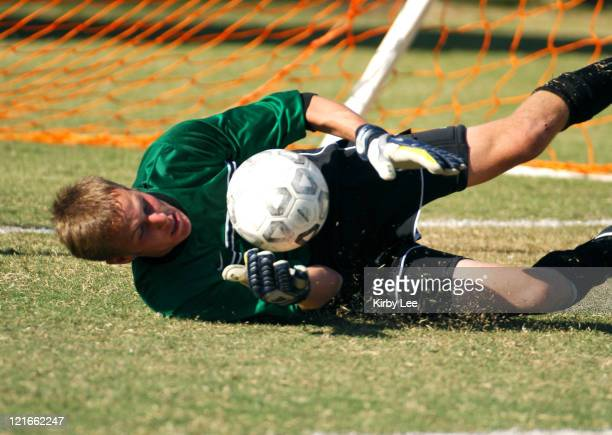 Occidental College freshman goalkeeper Matt Hergott makes a diving save during SCIAC men's soccer match against PomonaPitzer at Occidental College in...