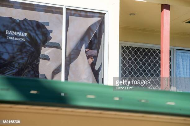 Occupants of Schappelle Corby's mother's house look out a window in Loganlea on May 28 2017 in Brisbane Australia Schapelle Corby was arrested in...