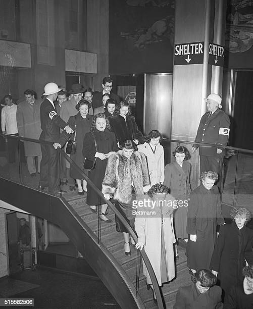 Occupants of the Eastern Airlines Building in Rockefeller Center make their way to the basement shelter during an air raid drill