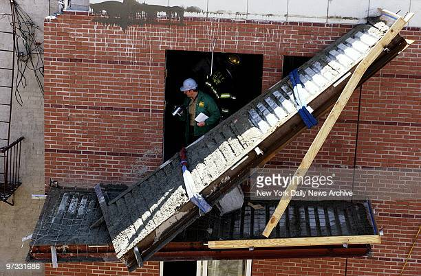 Occupational Safety and Health Administration inspector videotapes the scene after a balcony collapsed and a day laborer fell to his death at a...