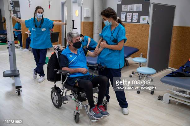 Occupational therapist Marta Ramírez 32 congratulates during a rehab session to patient Jose Cobollo 54 who suffered brain damage after a cerebral...