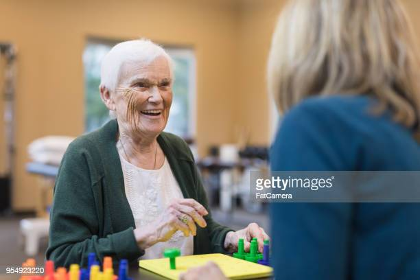 Occupational therapist works with an elderly woman