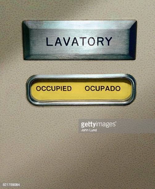 occupied airplane lavatory - airplane bathroom stock pictures, royalty-free photos & images