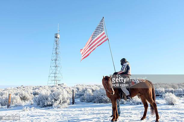 Occupier Duane Ehmer and his horse Hellboy stand at the entrance to the Malheur National Wildlife Refuge Headquarters in Burns Oregon on January 15...