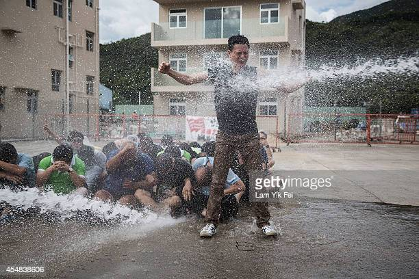 Occupy Central supporters attend a training camp which equips them with experience facing water cannons and police crackdown at Tai Lam Chung on...