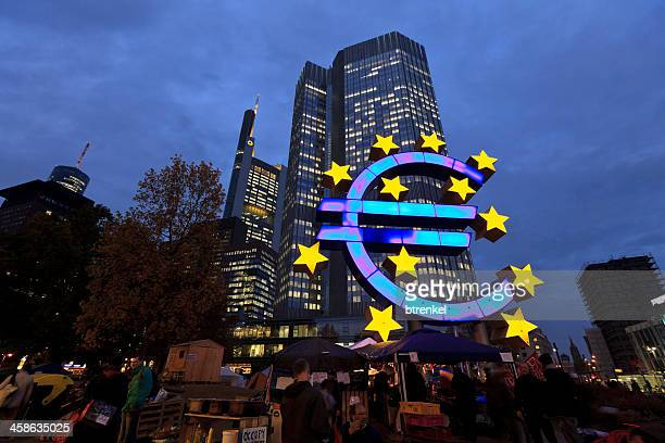 occupy movement & european central bank at dusk - european central bank stock pictures, royalty-free photos & images