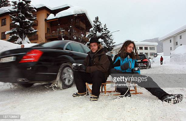 Occupy protesters make noise clanking pots in front of the main gate to Davos congress center on January 25 2012 in Davos Switzerland Several hundred...
