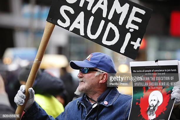 Occupy Wall Street activist Jack Joseph with array of signs Hundreds of Muslims gathered in Times Square to protest against the Saudi government's...