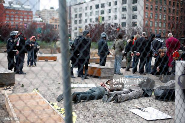 Occupy Wall Street activists are arrested for entering the private park owned by Trinity Church next to Duarte Square on December 17 2011 in New York...