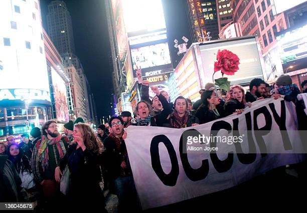 Occupy Wall Street activists demonstrate in Times Square on December 17, 2011 in New York City. Activists marked the three-month anniversary to the...