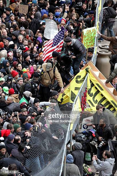 Occupy Wall Street activists gain entrance to a private park owned by Trinity Church next to Duarte Square at Sixth Avenue and Canal Street on...