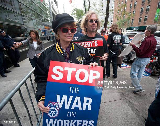 Anticapitalist protesters demonstrate against Wall St corporate greed Actress Susan Sarandon joins Teamsters and Occupy Wall Street protesters march...