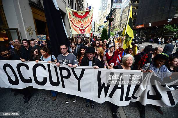Occupy Wall Street participants march down Fifth Avenue as part of May Day events in New York, May 01, 2012. The Occupy movement that shook the...