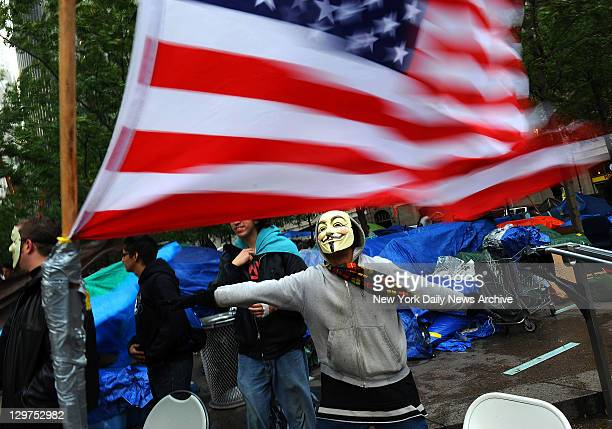 Occupy Wall Street protester Guy Fawkes with American flag at Zuccotti Park