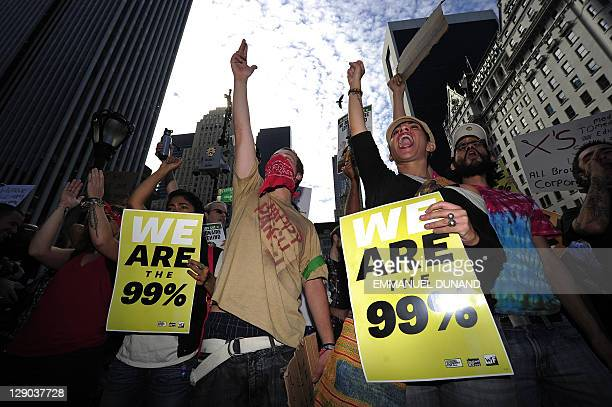 "Occupy Wall Street protestors stage a ""Millionaires March"" in Manhattan's Upper east Side, one the city's wealthiest residential neighbourhoods, in..."