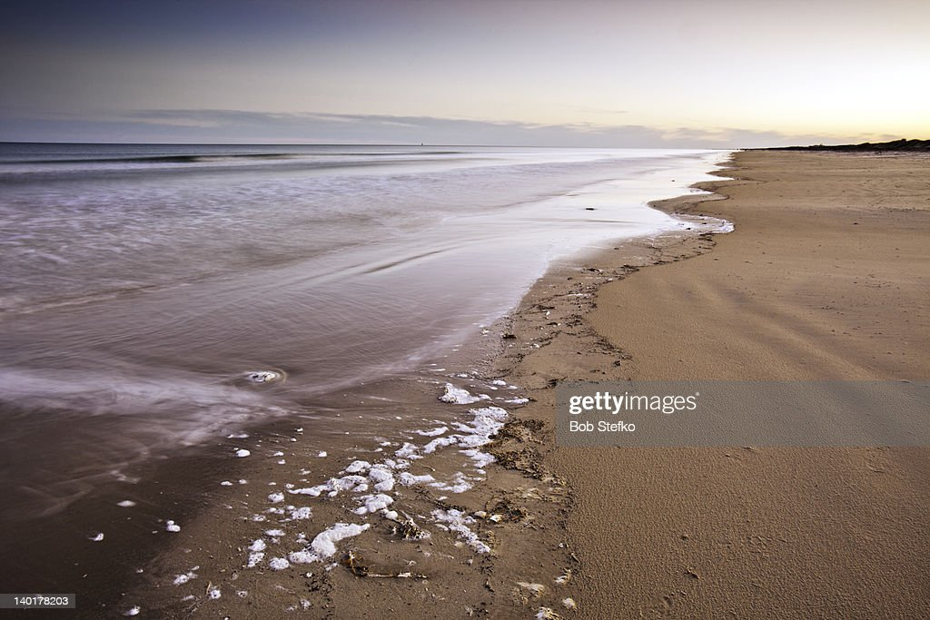 Ocean and beach at sunset : Stock Photo