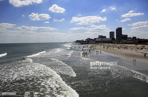 ocean and beach with cityscape of atlantic city - atlantic city stock pictures, royalty-free photos & images