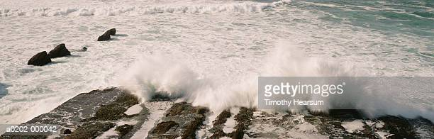 ocean and rocks - timothy hearsum stock-fotos und bilder