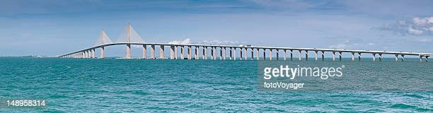 ocean bay bridge panorama usa - sunshine skyway bridge stock photos and pictures