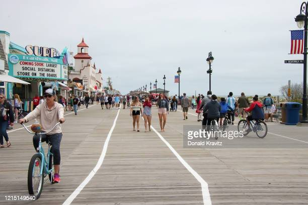 Ocean City continues celebrating Memorial Day weekend with many visitors bicycle riding and taking advantage of strolling on the Boardwalk on May 25,...